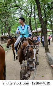 Yongin/Gyeonggi, Korea - July 05, 2014: Korean stuntman riding horseback after stage show at a traditional Korean folk village.