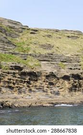 Yongmeori Coast(Dragon head coast), a tourist attraction famous for Multistory layered rough and strange sedimentary rocks in Jeju Island, Korea.