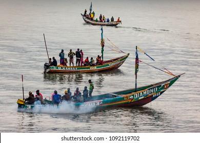 Yongoro, Sierra Leone - June 02, 2013: West Africa, the beaches of Yongoro, unknown fishermen sail towards the capital of the Sierra Leone, Freetown