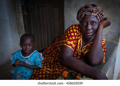 Yongoro, Sierra Leone - June 02, 2013: West Africa, the village of Yongoro in front of Freetown, woman with her baby