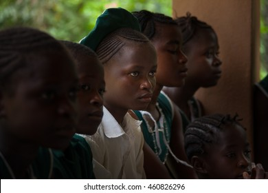 Yongoro, Sierra Leone - June 03, 2013: West Africa, the village of Yongoro in front of Freetown, young girl listen to the lesson at school