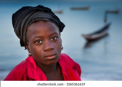 YONGORO, SIERRA LEONE - June 05, 2013: West Africa, portrait of an unknown girl near the beach with fishing boats in front of the capital Freetown, Sierra Leone