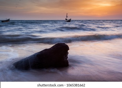 YONGORO, SIERRA LEONE - June 05, 2013: West Africa, the beach at sunset with fishing boats in front of the capital Freetown at sunset, Sierra Leone