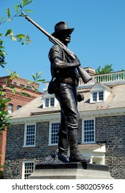 Yonkers, New York - July 13, 2009:   World War I doughboy soldier monument and statue in stands opposite the south front of 1682 Philipse Manor Hall