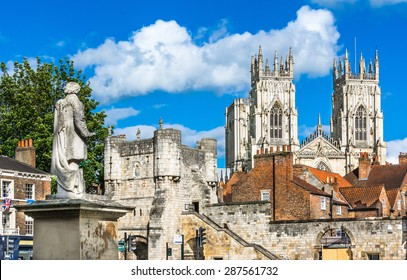 York, city view with the mediaeval gate, tower and York Minster in the background,England, UK, Europe