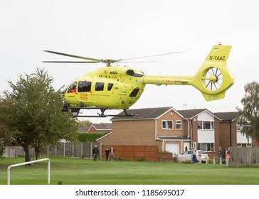 YORK, ENGLAND, 22 SEPTEMBER 2018. The Yorkshire Air Ambulance landing on a playing field in York, England while on a rescue mission.