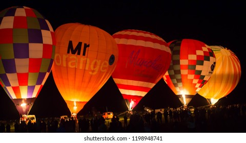 YORK, ENGLAND 28 SEPTEMBER 2018. Hot air balloons being inflated and illuminated at night on York's Knavesmire.