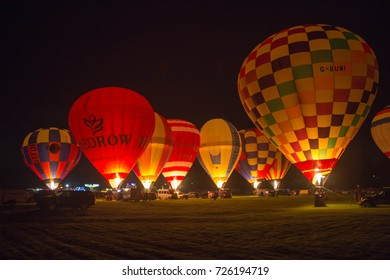 YORK, ENGLAND 30 SEPTEMBER 2017 Hot air balloons being inflated and illuminated at night on York Knavesmire, United Kingdom