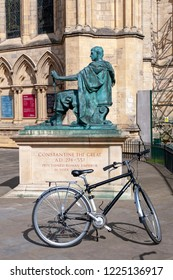 York, England - April 2018: A bicycle at statue of Constantine The Great outside York Minster, the historic cathedral built in English gothic architectural style and landmark of the City of York, UK