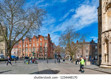 York, England - April 2018: Dean Court, historic building built by red brown bricks located in front of York Minster in the city of York, North Yorkshire, England, UK