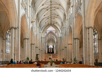 York, England - April 2018: Magnificent gothic nave inside York Minster, historic cathedral built in English gothic architectural style and major tourist landmark of City of York in England, UK