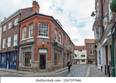 York, England - April 2018: Old brick building at corner of Swinegate Street in historic district of City of York, England, UK