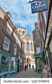 York, England - April 2018: Shops along Minster Gates street near York Minster in historic district of City of York, England, UK