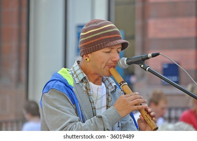 YORK, ENGLAND - AUGUST 14: Peruvian Busker Playing a Recorder Type Instrument in York City Centre to the Crowds on August 14, 2009 at the York Summer Fair in York, England.