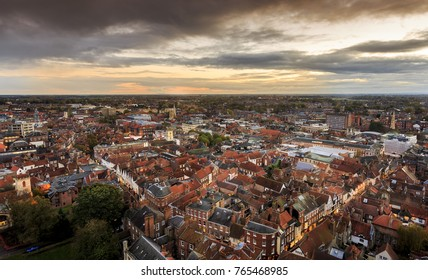York England city landscape of houses from high up over the roof tops at sunset.