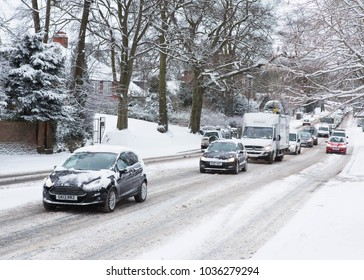 YORK, ENGLAND FEBRUARY 28 2018 TRAFFIC HAVING DIFFICULTY CLIMBING A HILL IN YORK DURING SNOWY WEATHER.