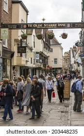 York, England - June 16: Streets of York, England, on June 16, 2014. York is an historic walled city at the confluence of the Rivers Ouse and Foss in North Yorkshire, England.