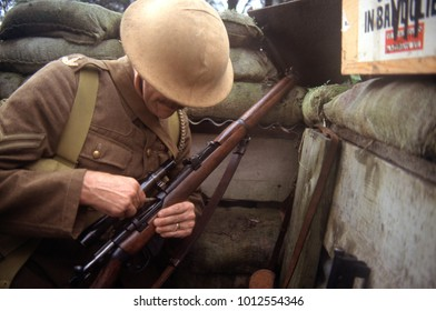 York England September 1998. Reenactor of WW1 wearing historic uniform of the period and loading a sniper rifle.