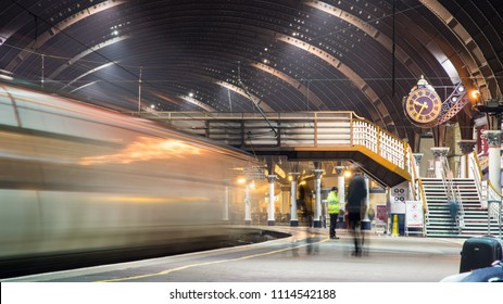 York, England, UK - January 29, 2017: Passengers at York railway station await the departure of a Virgin Trains East Coast intercity train.