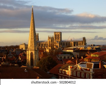 York England view over rooftops towards York Minster cathedral at sunset