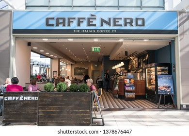 York / Great Britain - March 29, 2019 : Exterior of Caffe Nero inside a shopping centre mall.  Shows company logo, sign, branding and customers in seating area.