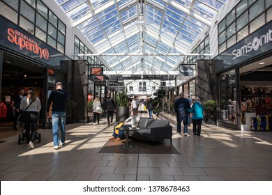 York / Great Britain - March 29, 2019 : Interior view of shopping centre showing shop fronts, customers and seating area
