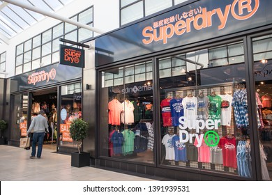 York / Great Britain - March 29, 2019 : Entrance to Superdry fashion clothing shop store showing window display, sign, signage, logo and branding.