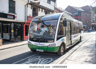 York / Great Britain - March 29, 2019 : Green Connexions branded bus on the street in sunshine.  Public transport in urban environment.  Optare bus.
