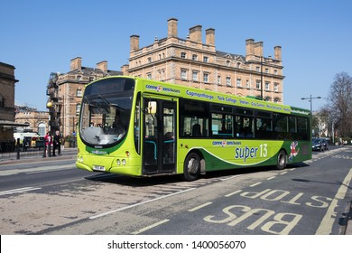 York / Great Britain - March 29, 2019 : Green Connexions branded bus on the street in sunshine.  Public transport in urban environment