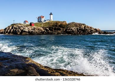 "YORK, MAINE, USA - OCTOBER, 10, 2016: Cape Neddick ""Nubble"" Lighthouse in York with blue sky"