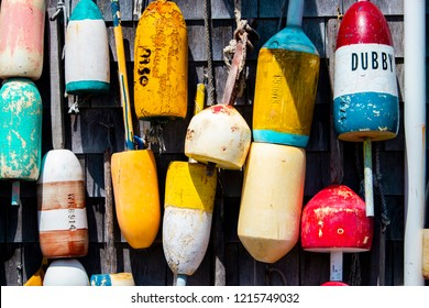York, Maine, USA: October 28th, 2018: Lobster buoys hang on the outside wall of a fishing shack.