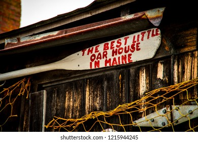 "York, Maine USA: October 28th 218: A painted white boat oar with the words "" THE BEST LITTLE OAR HOUSE IN MAINE"" hangs on the wall of a fishing shack. There are a lot of proud fishermen in Maine."