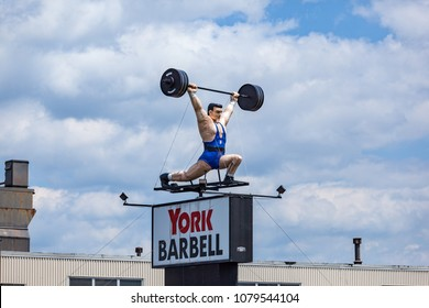 York, PA, USA - June 2, 2012:  The York Barbell Man sign at the factory in York County, PA.