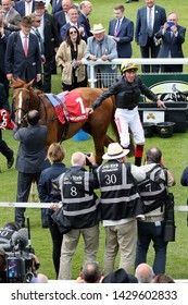 YORK RACECOURSE, NORTH YORKSHIRE, UK : 17 MAY 2019 : Jockey Frankie Dettori executes a flying dismount in front of photographers after winning the Yorkshire Cup on Stradivarius at York Races