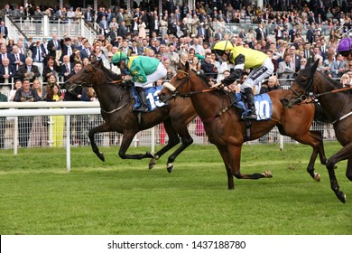 YORK RACECOURSE, NORTH YORKSHIRE, UK : 14 JUNE 2019 : Shawaamekh on the far side ridden by David Nolan wins the Irish Thoroughbred Marketing Stakes over 7f in  front of Proud Archi at York Races