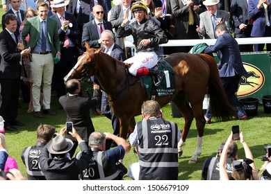 YORK RACECOURSE, NTH YORKSHIRE, UK : 23 AUGUST 2019 : Frankie Dettori treats the crowd to a Flying Dismount after winning the Group 2 Lonsdale Cup over 2m at York on Stradivarius