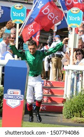 YORK RACECOURSE, NTH YORKSHIRE, UK : 24 AUGUST 2019 : Top jockey Frankie Dettori is announced and makes a grand entrance into the Parade Ring prior to the start of the £1,000,000 Sky Bet Ebor at York