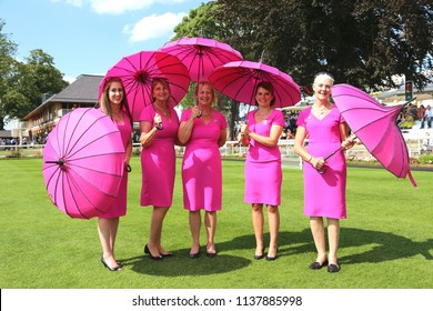 The York Racecourse Pink Lady Team in the Parade Ring with parasols at York Races on John Smiths Cup Day : The Knavesmire, York Racecourse, Nth Yorkshire, UK : 14 July 2018 : Pic Mick Atkins