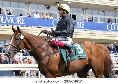 YORK RACECOURSE, YORK, UK : 20 August 2021 : Frankie Dettori and Stradivarius parade in front of the grandstands after winning the Group 2 Lonsdale Cup at York Races