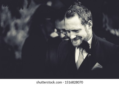 York, UK - 18th August 2019: A stylish looking best man at an outdoor Wedding