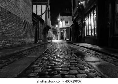 YORK, UK - April 12: Cobbled street at night on April 12, 2016 in York.