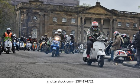 York UK April 28 2019 Scooterists & motorcyclists leaving York on a Charity scooter run many on Vespa & Lambretta scooters associated with the subcultural Mod (Modernist) movement