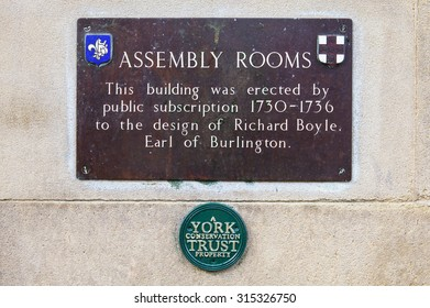 YORK, UK - AUGUST 25TH 2015: A plaque detailing the history of the Assembly Rooms building in York, on 25th August 2015.