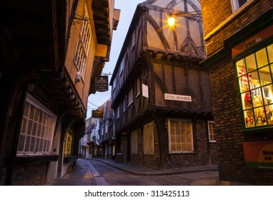 YORK, UK - AUGUST 28TH 2015: A view of the Shambles in York, on 28th August 2015.  It is one of the oldest streets in York with some of the timber-framed buildings dating from the fourteenth century.