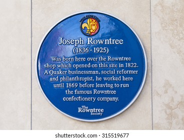 YORK, UK - AUGUST 28TH 2015: A plaque marking the location where, in 1836, Joseph Rowntree was born in York, on 28th August 2015.  Rowntree was the owner of the famous Rowntree Confectionery Company.