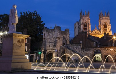 YORK, UK - AUGUST 29TH 2015: An evening view from the York Art Gallery taking in the sights of the William Etty statue, Bootham Bar and the towers of York Minster in York, on 29th August 2015.