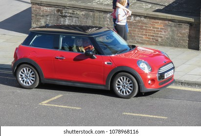 YORK, UK - CIRCA AUGUST 2015: red Mini Cooper car (new model, produced from 2013 onwards) with black roof