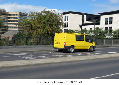 YORK, UK - CIRCA AUGUST 2015: yellow Ford Transit van in a street of the city centre.
