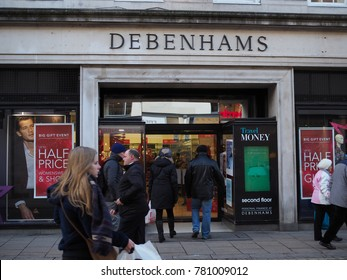 York, UK - Dec 14, 2017: People and tourist walk and heading to Debenhams department store in York, UK. Debenhams has 178 locations across the UK, Ireland and Denmark.
