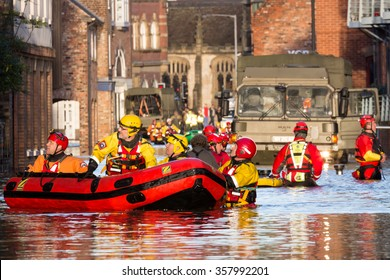 YORK, UK - DECEMBER 27th 2015: Flood rescue by the British Army and the Mountain Rescue at Queens Staith Road near the Ouse Bridge in York City Centre after heavy rain, on 27th December  2015.